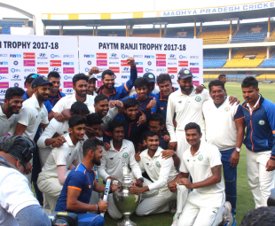 The Vidharbha team pose with the trophy