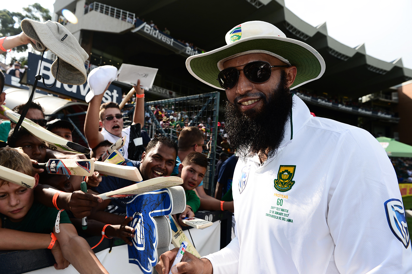 Hashim Amla signs autographs for fans