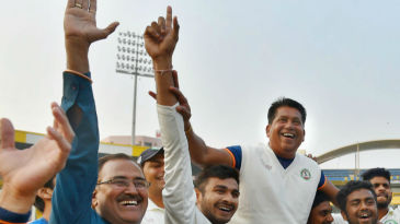 Vidarbha players hoist their head coach Chandrakant Pandit on their shoulders
