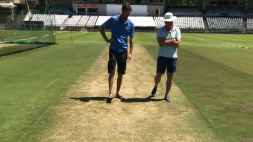 Curator Evan Flint (left) inspects the pitch at Newlands