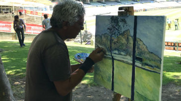 Envar Larney, a renowned impressionist painter, sets out to paint the stadium, Table Mountain included