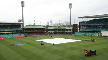 The covers were on at the SCG as rain delayed the toss