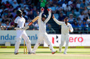 Virat Kohli and Wriddhiman Saha celebrate the wicket of Kagiso Rabada, South Africa v India, 1st Test, Cape Town, 1st day, January 5, 2017