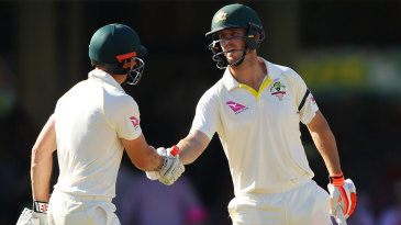 Mitchell Marsh gets a handshake from his brother on reaching fifty