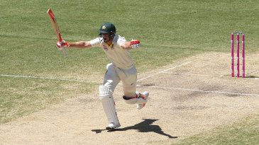 Mitchell Marsh spreads his arms in delight on reaching his hundred