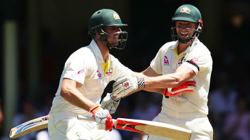 The Marsh brothers get in a tangle while celebrating Mitchell's century
