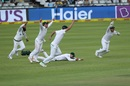 The South Africa players celebrate after Faf du Plessis completes the winning catch, South Africa v India, 1st Test, Cape Town, 4th day, January 8, 2018