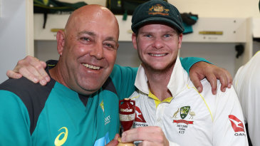 Steven Smith and Darren Lehmann pose with the Ashes Urn