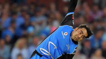 Rashid Khan delivers the ball