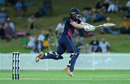 Eoin Morgan leaps into a stroke, Cricket Australia XI v England, Tour match, Sydney, January 11, 2017