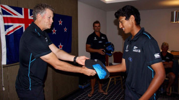 Rachin Ravindra receives his cap from Paul Wiseman