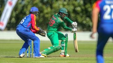 Saif Hasan glides the ball away