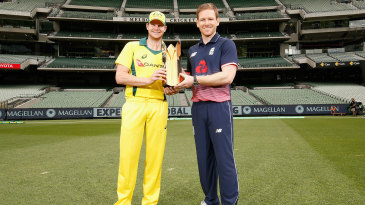 Steven Smith and Eoin Morgan pose with the ODI series trophy