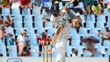 Virat Kohli leaps to play the ball