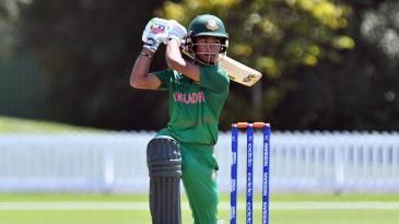 Afif Hossain flays the ball through cover
