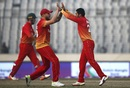 Sikandar Raza and Kyle Jarvis celebrate Anamul Haque's wicket, Bangladesh v Zimbabwe, tri-series, Mirpur, January 15, 2018