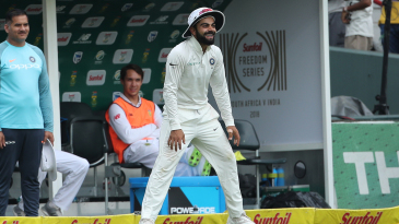 Virat Kohli has a laugh while fielding at the boundary