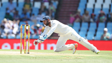 Parthiv Patel gathers a ball
