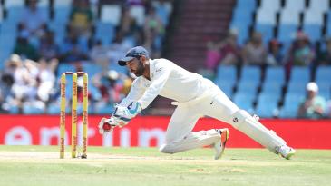 Parthiv Patel gathers a ball