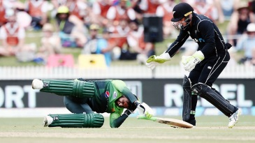 A helmet-less Shoaib Malik was hit in the back of the head by a Colin Munro throw