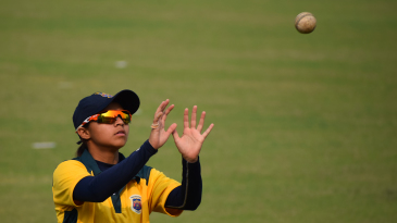 Devika Vaidya prepares to catch the ball during warm-up
