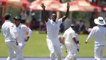 Lungi Ngidi raises his hands in triumph