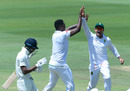 Lungi Ngidi and Dean Elgar celebrate the wicket of Hardik Pandya, South Africa v India, second Test, Centurion, day five, January 17, 2018