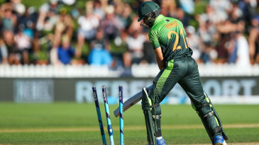 Mohammad Nawaz looks on after losing his stumps