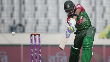 Anamul Haque punches through the covers