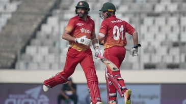 Brendan Taylor and Graeme Cremer run between the wickets