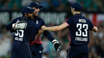 Jos Buttler, Adil Rashid and Mark Wood celebrate victory