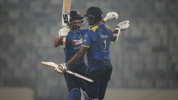 Dinesh Chandimal celebrates Sri Lanka's win with Thisara Perera