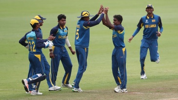 Sri Lanka players celebrate a wicket