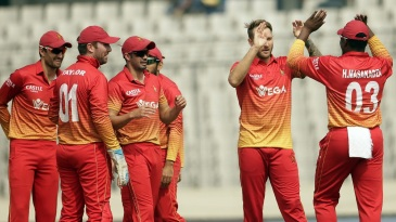 Kyle Jarvis celebrates Anamul Haque's wicket with his team-mates