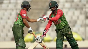 Tamim Iqbal and Shakib Al Hasan bump fists during their partnership