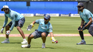 Dinesh Karthik attempts a catch in the presence of KL Rahul and M Vijay