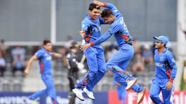 Mujeeb Zadran (right) is thrilled after taking a wicket