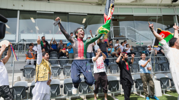 An Afghanistan fan goes up in delight