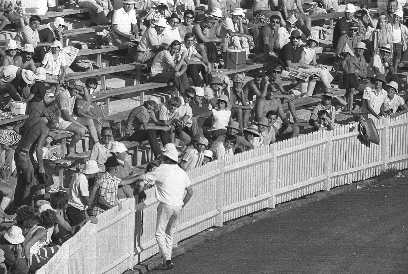 Snow has his arm grabbed by a spectator the day after he skulled Terry Jenner in the seventh Test of the 1970-71 Ashes