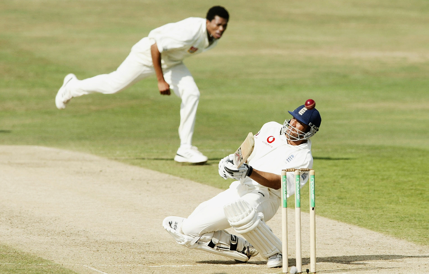 Mark Butcher ducks under a bouncer from Makhaya Ntini