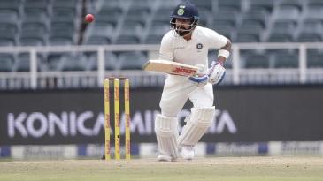 Virat Kohli taps the ball down the ground