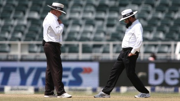 Umpires Ian Gould and Aleem Dar inspect the Wanderers pitch