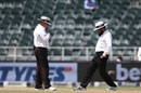Umpires Ian Gould and Aleem Dar inspect the Wanderers pitch, South Africa v India, 3rd Test, Johannesburg, 3rd day, January 26, 2018