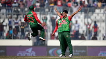 Mohammad Saifuddin celebrates his first ODI wicket