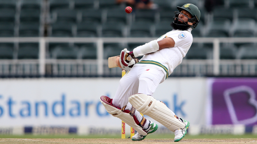 Hashim Amla takes evasive action against a bouncer