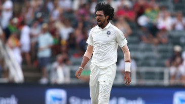 Ishant Sharma is congratulated by his team-mates upon picking up a wicket