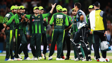 The Pakistan players celebrate the wicket of Ross Taylor following the review