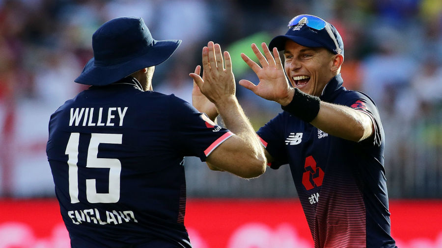 Tom Curran and David Willey celebrate the wicket of Marcus Stoinis