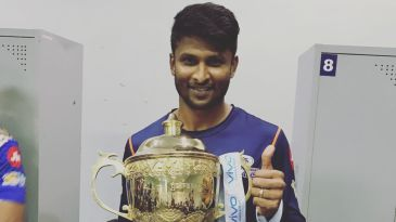 K Gowtham with the IPL trophy