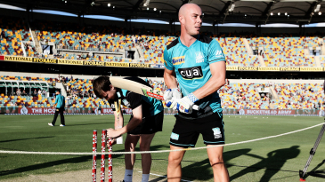 Chris Lynn gets ready for the match with some visualisation on the pitch